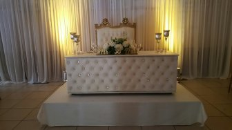 Gold Love Seat and White Leather Table
