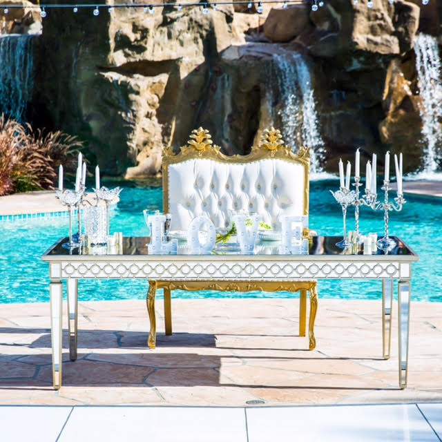 mirror-head-table-and-gold-love-seat